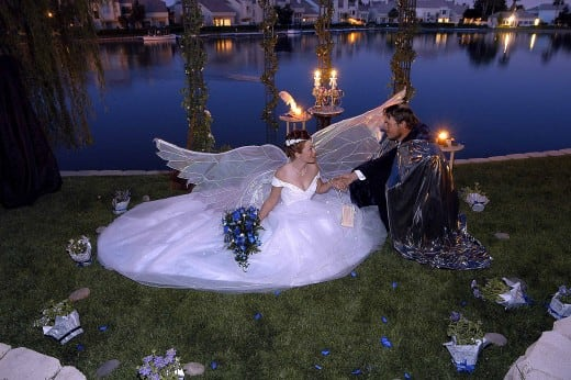 Angelic fairy winged bride and her prince charming