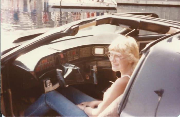 Cheryl sitting in the car KITT.