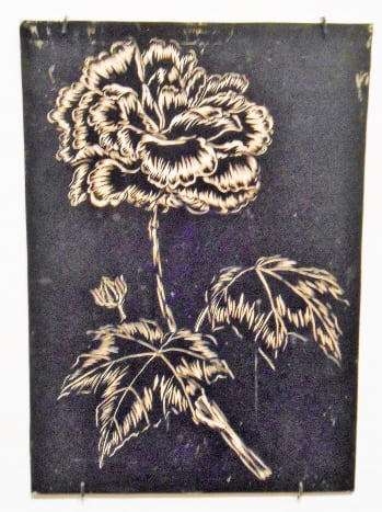 Flower with leaves inked print block image.