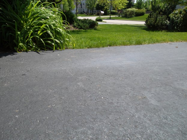Use a pressure washer to clean driveways before sealing