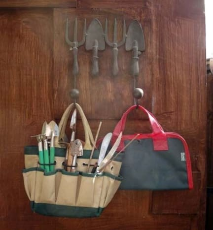 Decorative hooks on the inside of the door for hanging tool bags.