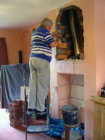 A friend helping me a few years ago to add an arched recess above the old fireplace