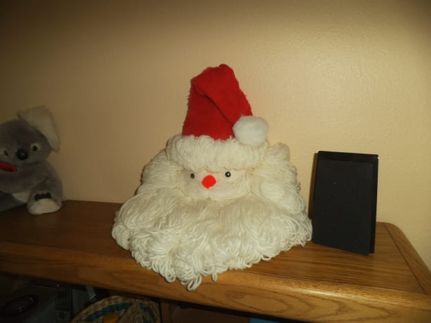 It's hard to chose the best place to display the yarn Santa face. It looks good anywhere you put it.