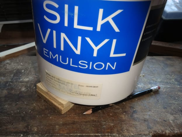 Using a 5L tin of paint as a template to mark the top curve.