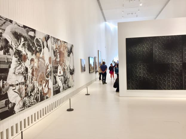 """Black Star Press (rotated 90 degrees clockwise); Press, Black Star"", 2006 by Kelley Walker and ""Come Out #13"", 2015 by Glenn Ligon."