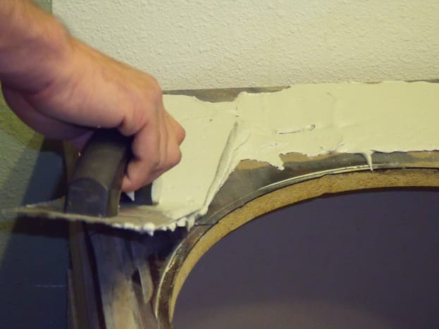 Use a trowel to apply a thin layer of mortar to countertop.