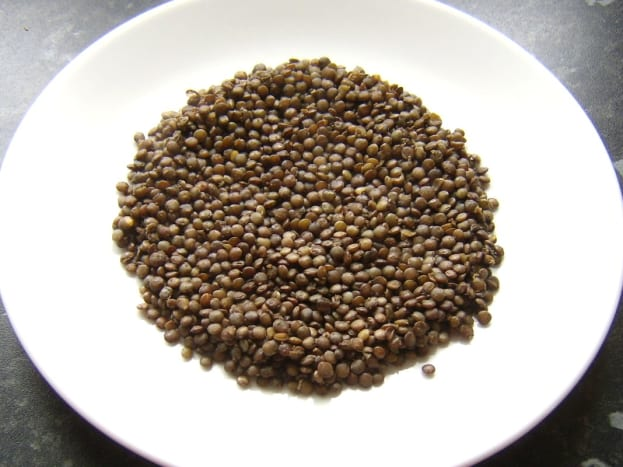 Lentils are laid on serving plates first