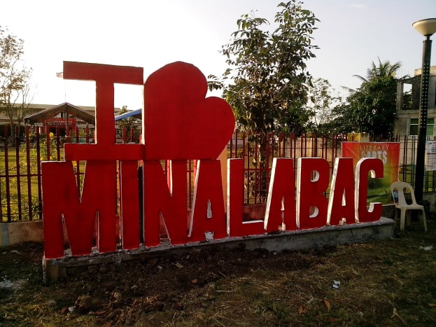 Newly-painted Minalabac signage (Photo Source: Ireno A. Alcala)