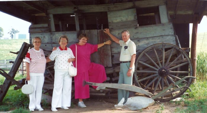 My aunt, mother, me, and my uncle are standing in front of an old stagecoach on the grounds of the Cody Homestead.