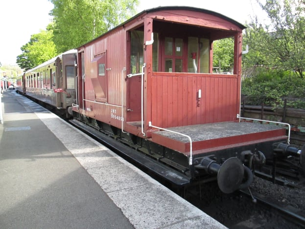 British Railways based the standard goods brake van on the LNER 'Toad D' pattern, taking that a stage further with front and rear hand rails mounted either side on the weighted ends. This is the brake fitted version for express goods - Grosmont, NYMR