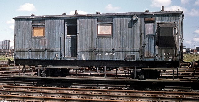 Early 'matchboard'  North Eastern ballast brake van at Alexandra Dock Hull awaiting scrapping or preservation - one stands on the sidings at Goathland behind 'Up' platform