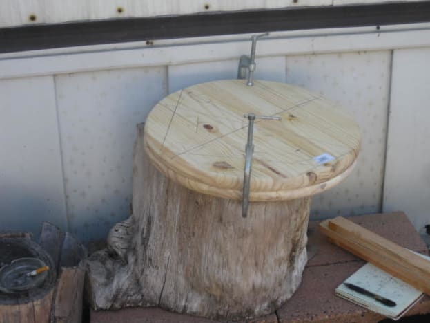 Here a stump used to look at the garden with is used for the flat surface for drilling the holes. A Workmate by Black & Decker is a good tool to use too.