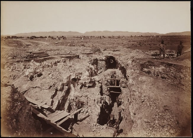 "The ""Old South Shaft Ore Quarry, Face of Tough-nut Mine, part of Town of Tombstone, Arizona. Dragoon Mountains, with Cochise Stronghold in background"" - Carleton E. Watkins, 1880"