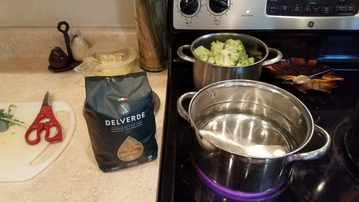 Chop your broccoli and start your broccoli and pasta cooking on the stove.