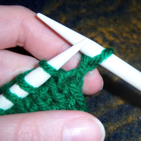 Knit one stitch.