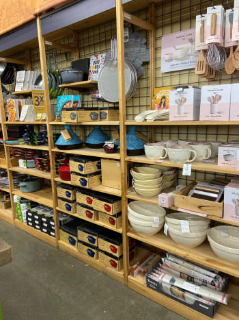 Assorted kitchen ware and tools from pots, pans, mixing bowls, spatulas, and more