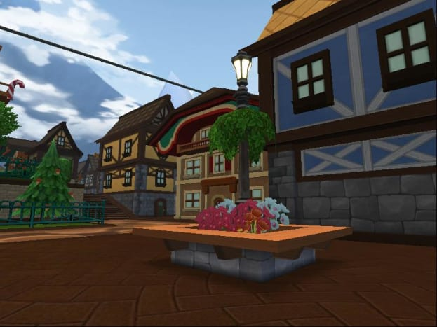 The Karamelle City Peanut Buttercups are cleverly hidden in a flowerbed next to the crafting vendors.