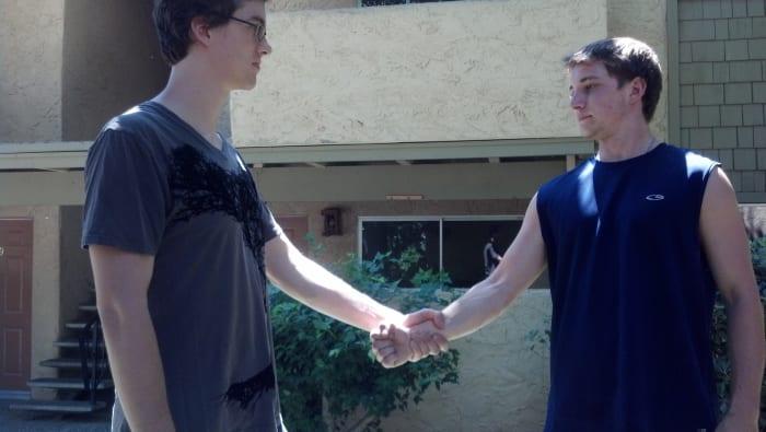 Attacker grabs defender's wrist