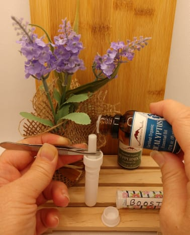 Adding essential oil drops to the inhaler wick.