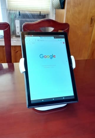 This stand can hold a tablet in virtually any position