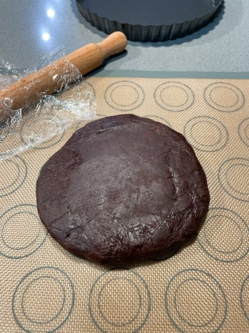 Take the chilled crust out from the fridge. Knead the chocolate pastry dough once or twice on a lightly floured (I used a baking mat) work surface to soften.