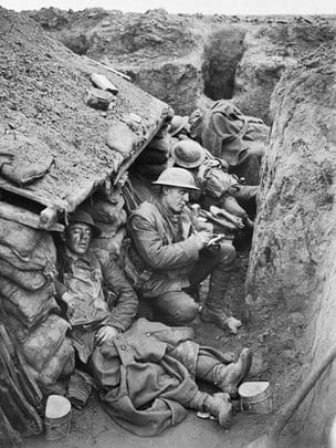 Canadian soldiers in the trenches writing letters home