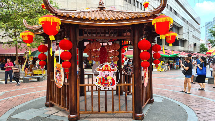 Waterloo Street festive market typically features a huge Cai-Shen, or Chinese God of Money, as its showpiece. In 2021 though, because of the COVID-19 pandemic, the statue was replaced by a festive pavilion.