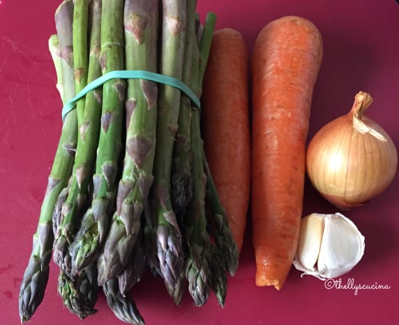 Some of the ingredients: asparagus, carrots, onion and garlic.