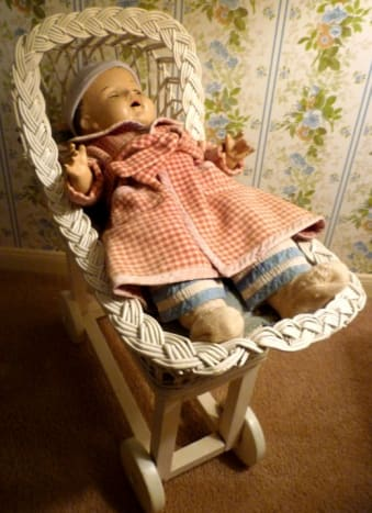 The doll Annette in her carriage
