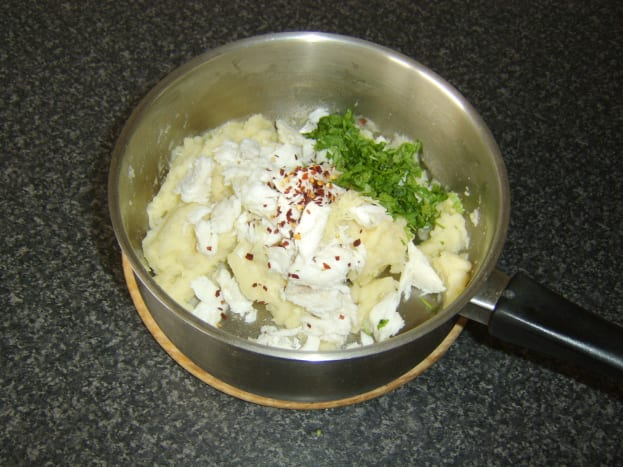 Additional fish cake ingredients are added to the mashed potato