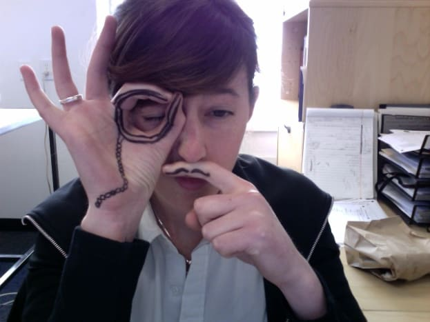 An interesting take is to tattoo a mustache on one finger and a monocle on the other.