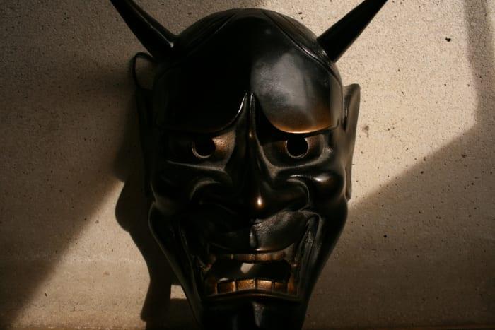 A carved black hannya mask.