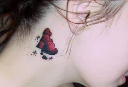 a heart below a person's ear
