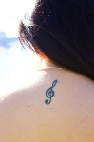 Treble clef tattoo.