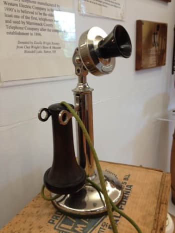 Although not visible here, the candlestick phone still required a ringer box and batteries to work.