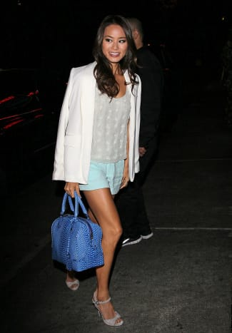 Layer with soft colors for spring and summer. Jamie Chung in mint shorts and a white blazer.