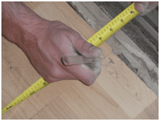 Measure and mark flooring and drywall to be removed,