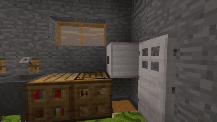 Opening the fridge door reveals an iron block and a chest built into the floor.