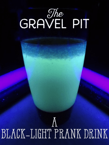 The drink glows a green color with thick, chunky bits at the top.