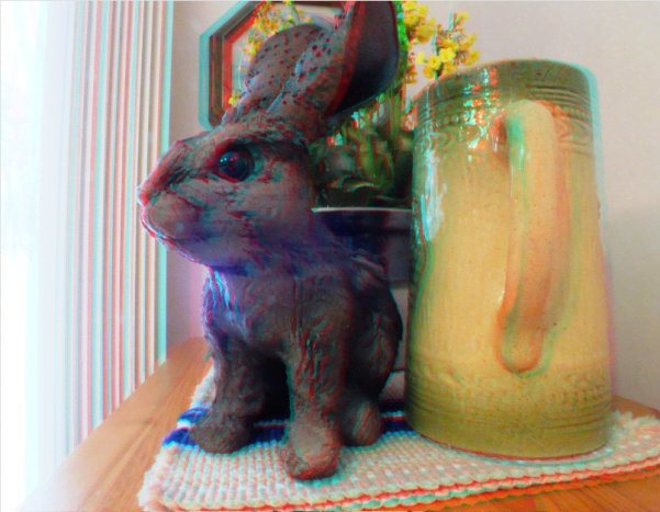 Red cyan 3D stereoscopic image of a bunny sculpture and a vase.