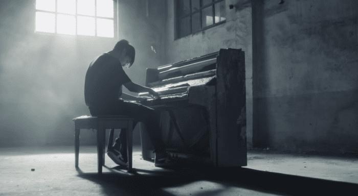 Jungkook playing the piano.