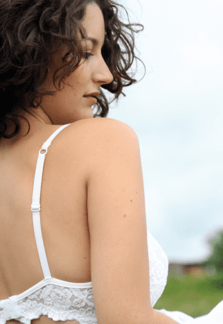 The back of your bra should go around you evenly similar to a belt. The back should not ride up your back, if it does, you need a different size bra.