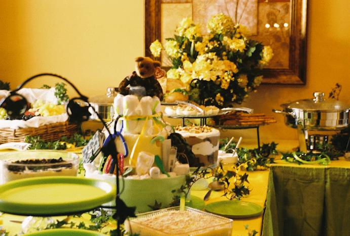 """Close up view of the bottom """"T"""" of the buffet table."""
