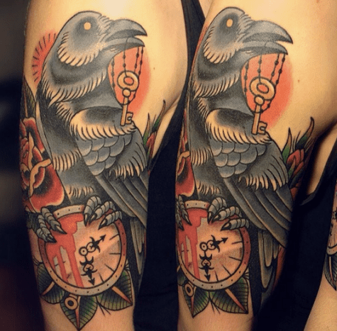 Raven, key, and clock tattoo.
