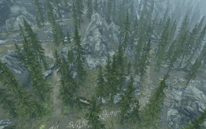 An aerial view of the path that leads up to the mountain seen to the left and the bandit towers to the right.