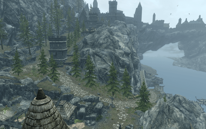View from Katla's Farm, the stables of Solitude, which players should travel from, taking the right path seen in this image to reach the lighthouse.