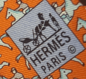 Look at the twill direction.  It is not running 11 to 5.  It is more East-to-West than a genuine Hermès tie.