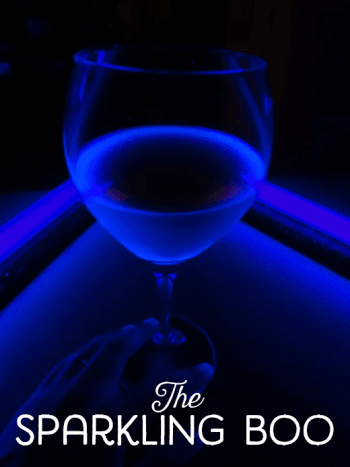 The drink glows a bright blue because of the tonic water.