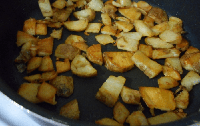 Three baked potatoes, sliced up into quarter thick pieces