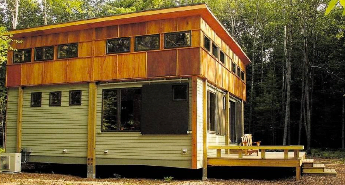 In this installed Ready Structures cottage, the exterior features fiber cement board (low maintenance), full-width wood deck, and plenty of windows.